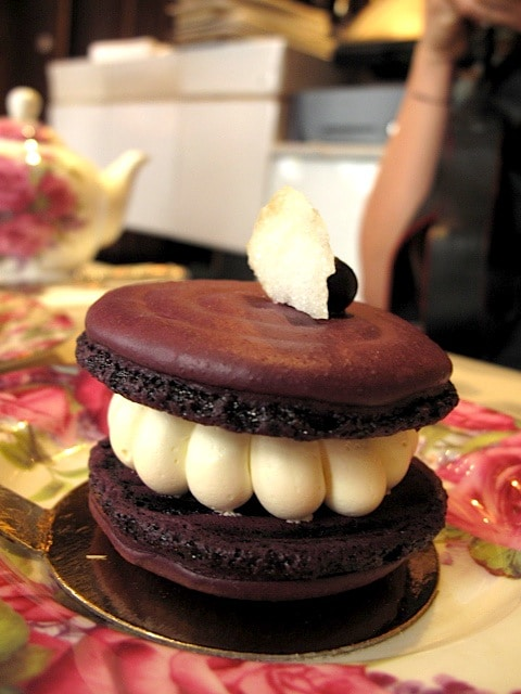 Cardinal - blackcurrant macaron, blackcurrant marmalade and violet mousseline cream, garnished with a blueberry and sugared petal
