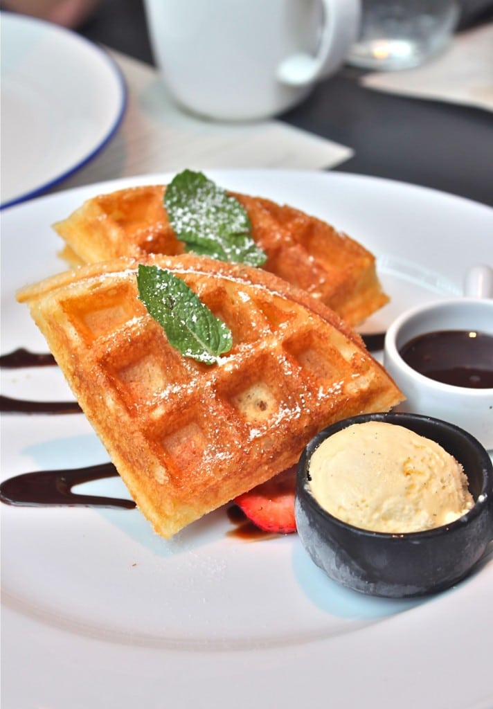 Orange and Vanilla Waffles – with chocolate sauce and cut strawberries